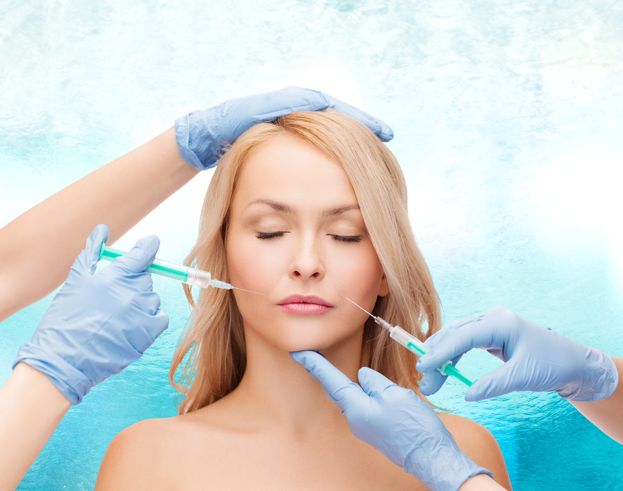 beauty and cosmetic surgery concept - woman with closed eyes and beautician hands with syringes