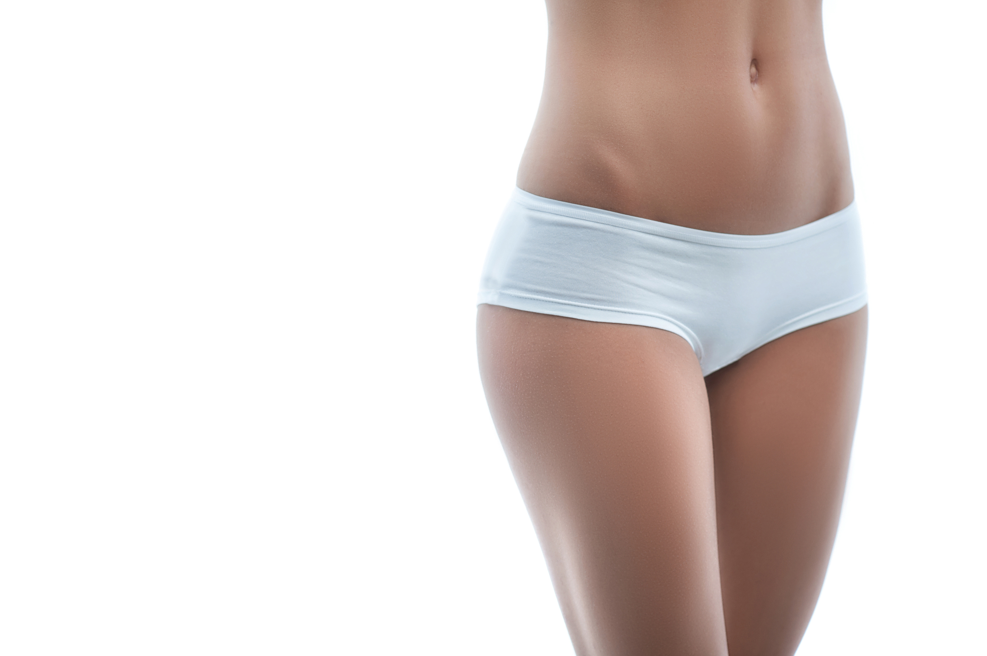 Look at my perfect figure. Close up of slim waist of young woman standing in white panties. Isolated and copy space in left side