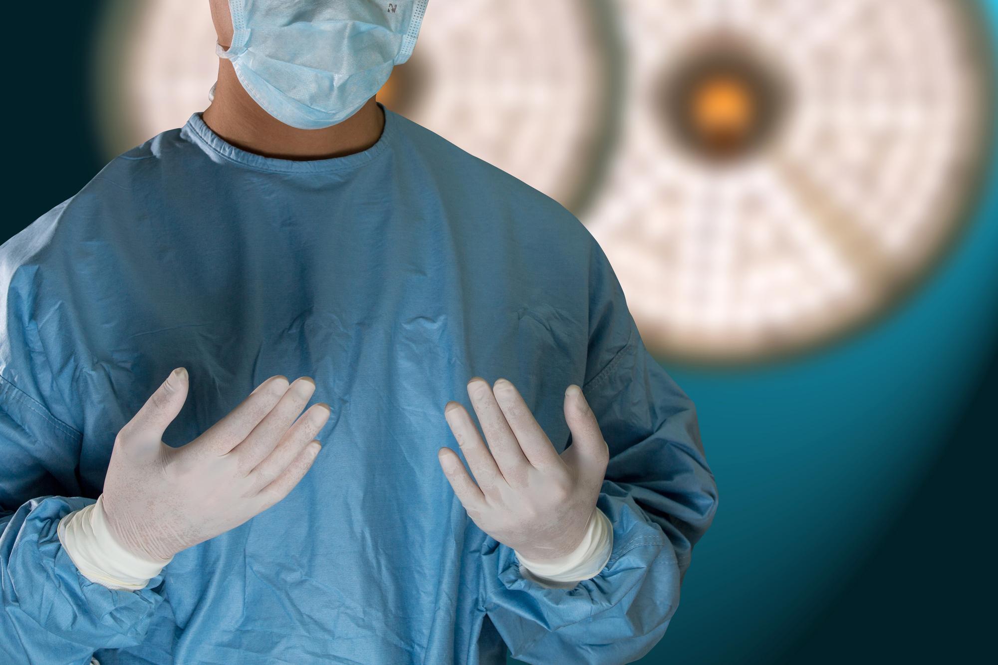 Doctor  prepare surgery equipment for help patient.